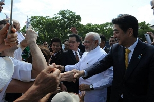 Narendra Modi and Japan PM Shinzo Abe shake hands with visitors at the Toji Temple in Kyoto. Photograph: MEA/Facebook