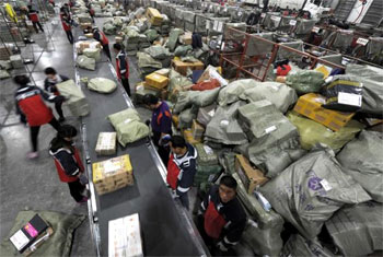 Workers sort packages at a logistics hub in Jinan, Shandong province, China. Photograph: Reuters