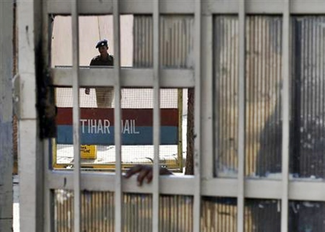 A policeman walks inside Tihar Jail in New Delhi.