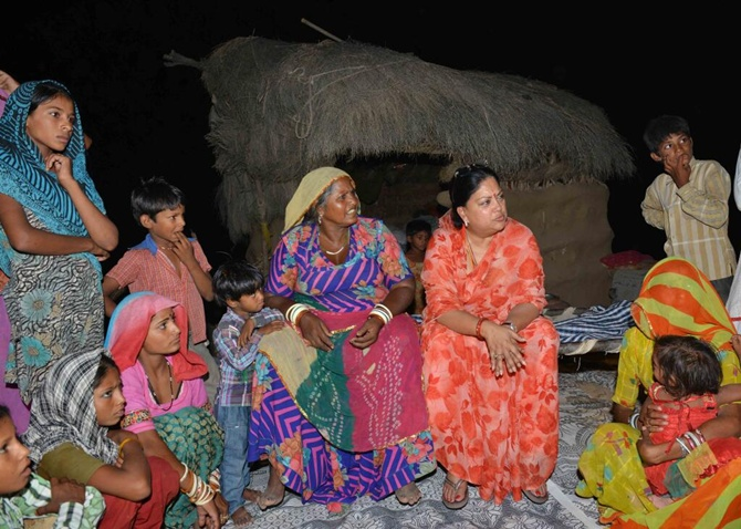 Rajasthan chief Minister Vasundhara Raje with villagers.
