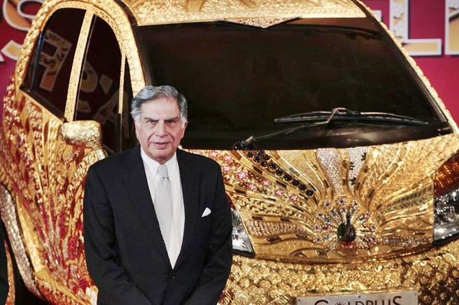 Chairman emeritus of Tata Group, Ratan Tata infront of the GoldPlus Tata Nano