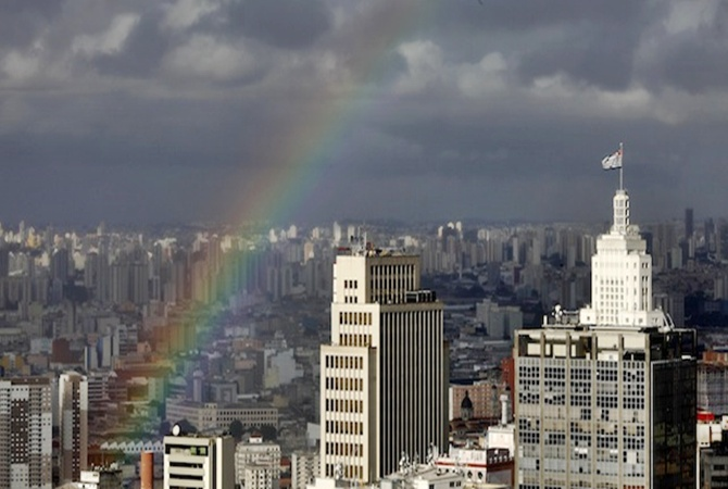 A rainbow appears over the sky of the city of Sao Paulo.
