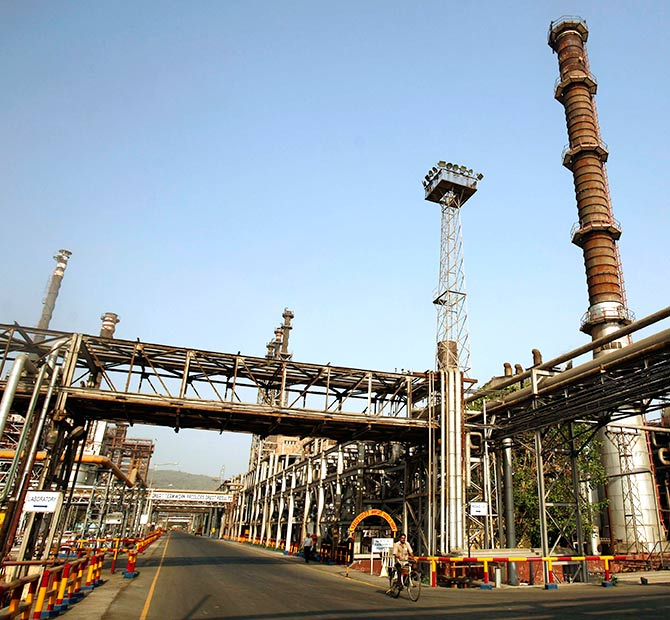 A worker rides a bicycle at the Bharat Petroleum Corporation Ltd. refinery in Mumbai.