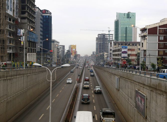 Cars drive out of an underpass in Addis Ababa.