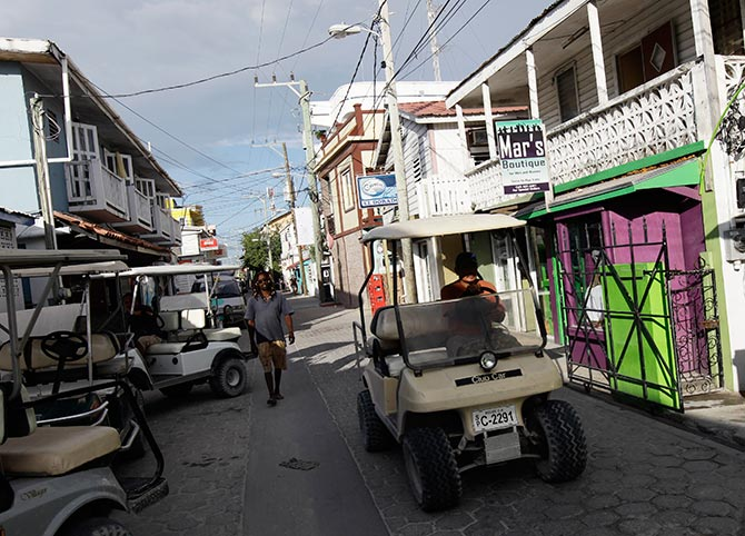 A man rides a buggy in the main square in San Pedro.