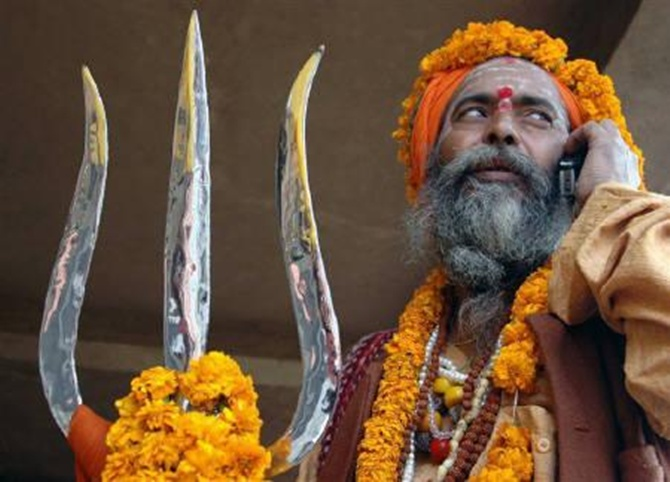 A holy man seen talking on a mobile phone in Varanasi