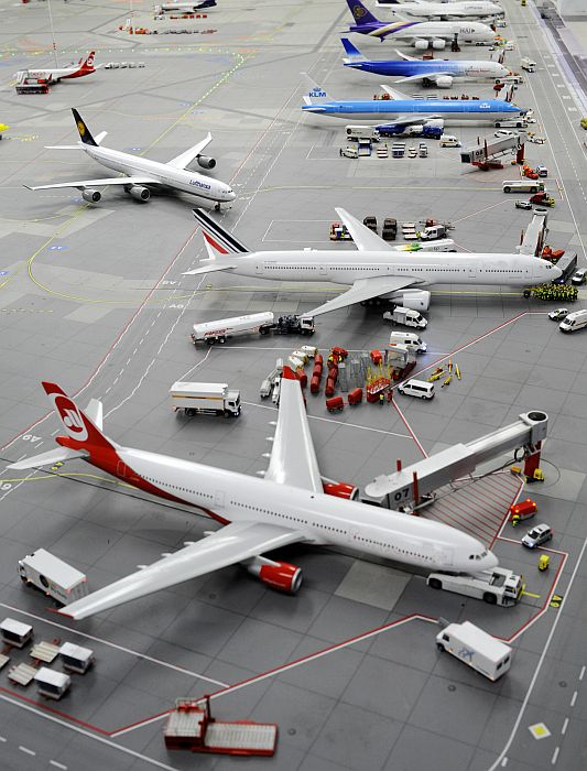 Models of planes are pictured at an airport.