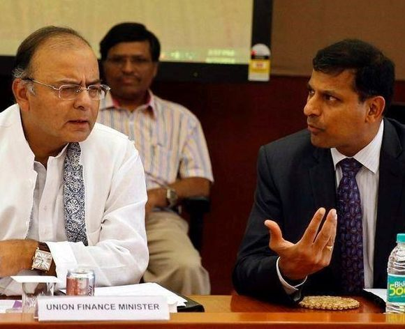India's new Finance Minister and Defence Minister Arun Jaitley (L) listens to Reserve Bank of India (RBI) Governor Raghuram Rajan during a financial stability development council meeting.