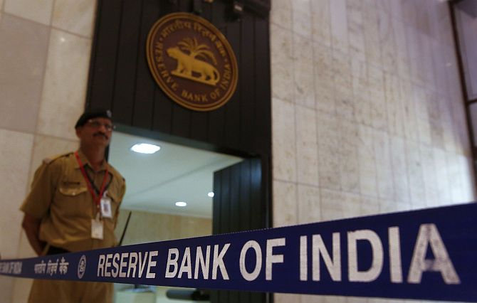 A security guard stands in the lobby of the Reserve Bank of India.