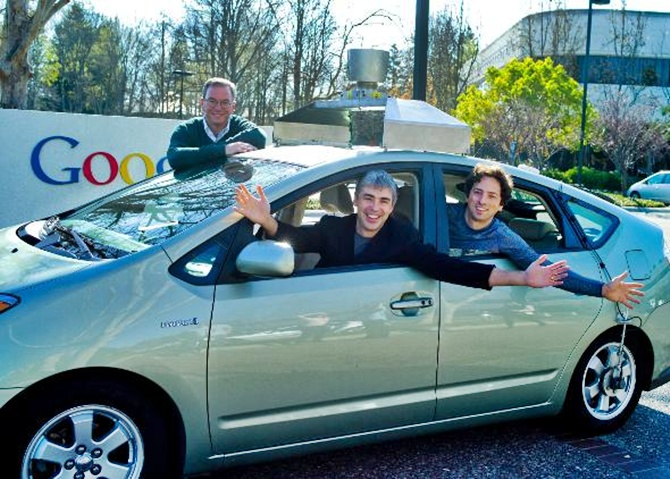 Eric Schmidt, Larry Page and Sergey Brin in a self-driving car.