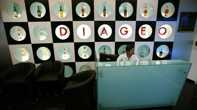 A receptionist sits at the office of Diageo, the world's largest alcoholic drinks maker, in Mumbai.