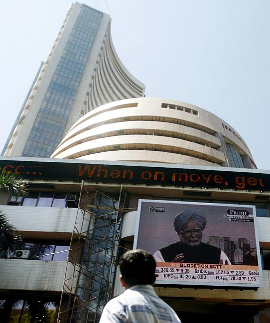 A man walks past the Mumbai Stock Exchange.