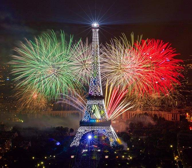The Eiffel Tower is illuminated during the traditional Bastille Day fireworks display in Paris.