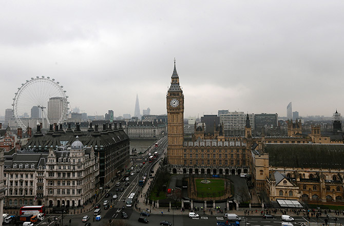 The Houses of Parliament and the London Eye are seen in central London.