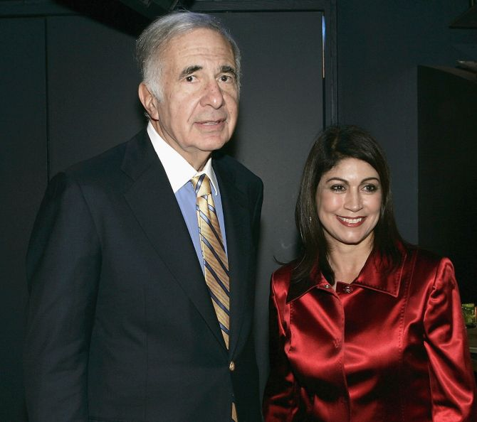 Carl Icahn is seen with owner Caroline Hirch at 'David Moore's Funny Business Show' at Caroline's on Broadway.