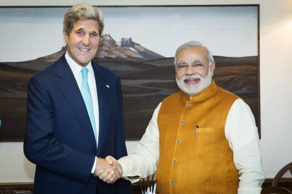 U.S. Secretary of State John Kerry (L) shakes hands with Indian Prime Minister Narendra Modi at the Prime Minister's residence in New Delhi August 1, 2014.