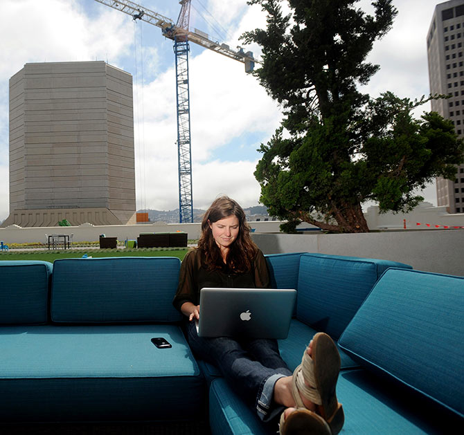 Jenna Sampson, a community relations manager at Twitter, works on the company's rooftop deck.