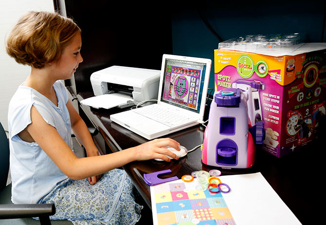 Ten-year-old Sara Seuri beta-tests Spotz, the first true convergence of online and offline play by Zizzle Toys.