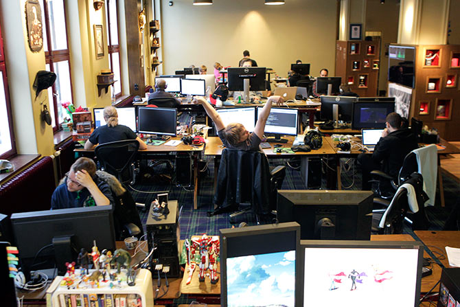 Coders work in the Mojang company office.