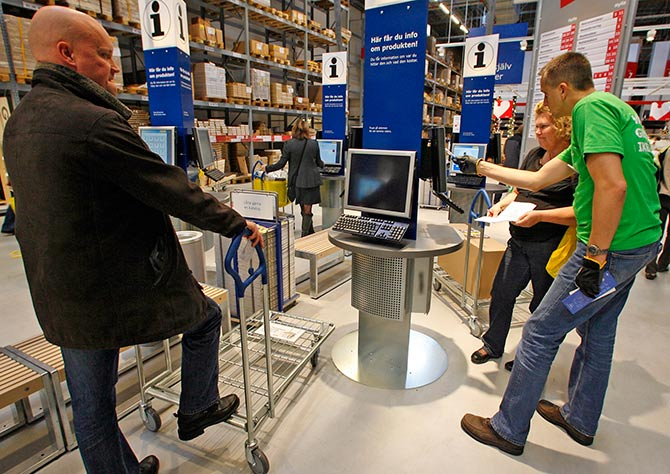 Customers check products on computer terminals at IKEA's newest store.