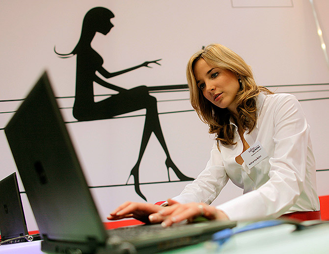 A model poses with a laptop during the CeBIT computer fair.