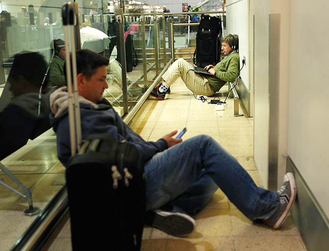 Passengers wait after short haul flights.