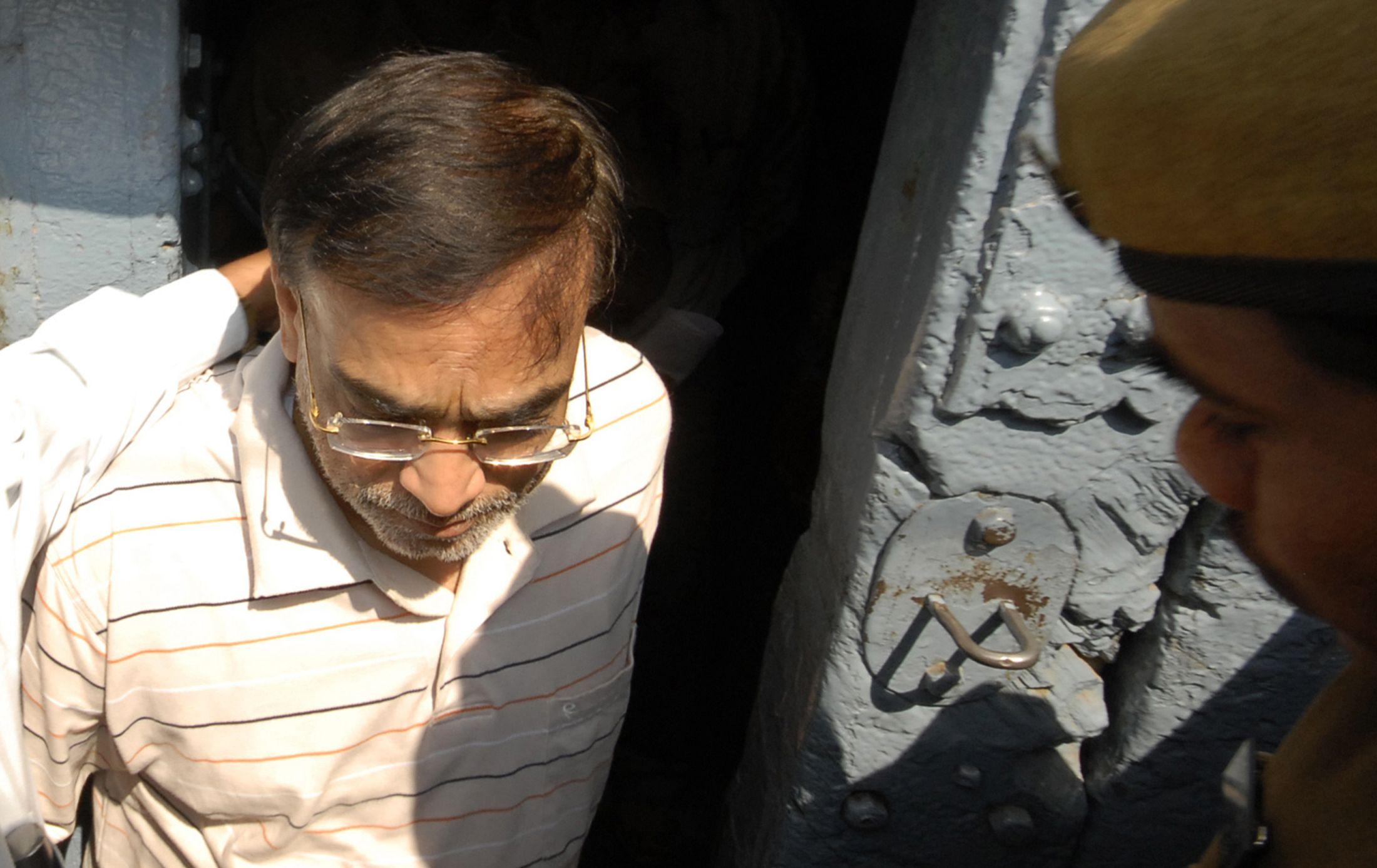 PricewaterhouseCoopers auditor S Gopalakrishnan being  taken to jail in the Satyam case.