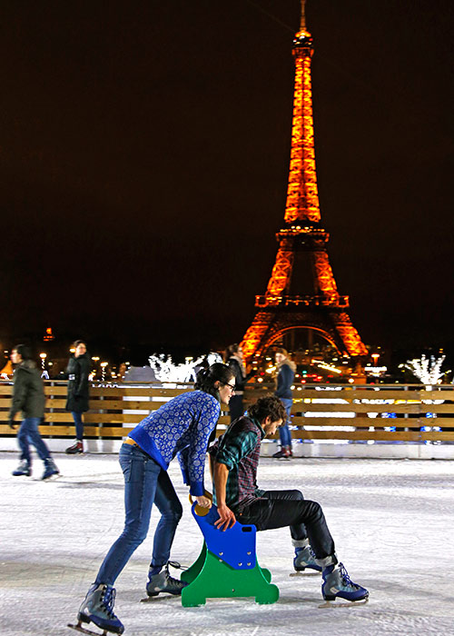 People ice skate on an artificial rink built for the Christmas holiday season across from the Eiffel Tower in Paris.