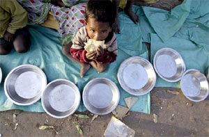 Image: A homeless boy eats as he begs for money in Kolkata. Photograph: Parth Sanyal/Reuters