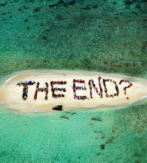 Hundreds of Belizians and international supporters gather on an island to form a message on the Barrier Reef off the coast of Belize City.