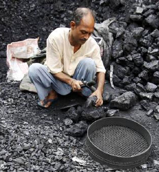 A labourer works at a wholesale coal shop in Kolkata. Photograpg: Rupak De Chowdhuri/Reuters