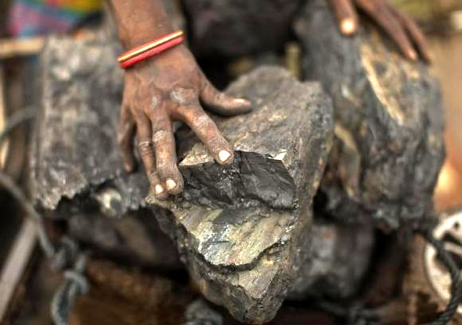 A local woman prepares to carry coal at an open coal field at Dhanbad, Jharkhand. Photograph: Ahmad Masood/Reuters