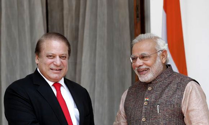 Prime Minister Narendra Modi (R) and his Pakistani counterpart Nawaz Sharif smile before the start of their bilateral meeting in New Delhi May 27, 2014. Photograph: Adnan Abidi/Reuters