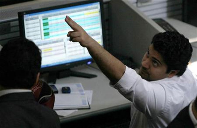 Traders work at a stock exchange.