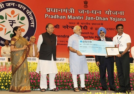 Prime Minister Narendra Modi presenting the award to Ajith Gurunathan for suggesting the name 'Pradhan Mantri Jan Dhan Yojana (PMJDY)', in New Delhi. Photograph: Courtesy, PIB