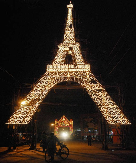 A Durga Puja pandal, built in the shape of Eiffel Tower of Paris, is illuminated in Ranchi.