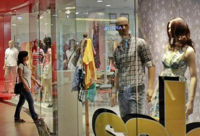 A woman enters a retail store inside a shopping mall in Mumbai.
