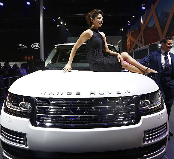 Bollywood actress Priyanka Chopra poses with Jaguar Land Rover's Range Rover LWB during its launch.