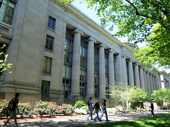 People walk outside Harvard Law School's Langdell Hall.