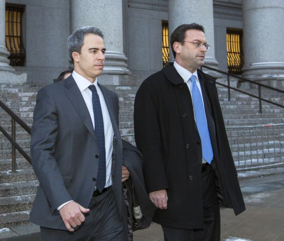 Michael Steinberg (L), a top portfolio manager at Steven A. Cohen's SAC Capital Advisors hedge fund, departs Federal Court in Manhattan after being found guilty on charges that he traded on insider information.