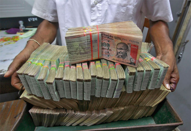 Rupee gains as trade gap shrinks
