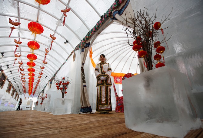 A waitress poses during a photo opportunity at the Ice Palace in Shangri-La Hotel in the northern city of Harbin, Heilongjiang province.