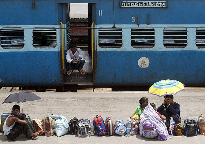 passengers queue up on the platform of the Howrah station in Kolkata.