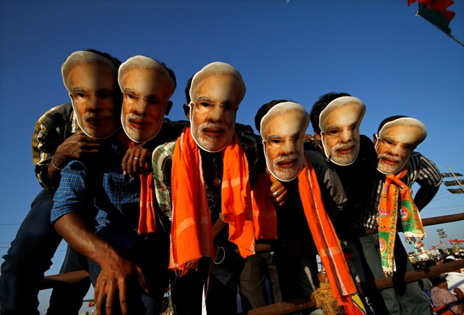 Supporters of Gujarat's chief minister Narendra Modi wear masks of Modi during a rally in Chennai.