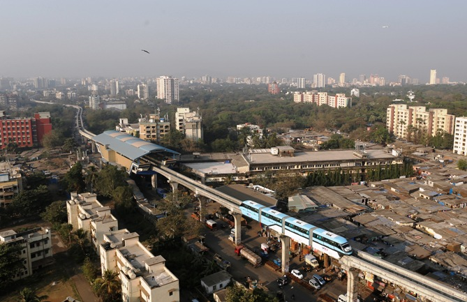 A Mumbai Monorail passes through a residential area in the eastern suburbs of Mumbai.