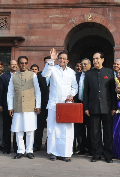 Finance Minister Chidambaram leaves North Block to Parliament House along with the Ministers of State for Fin