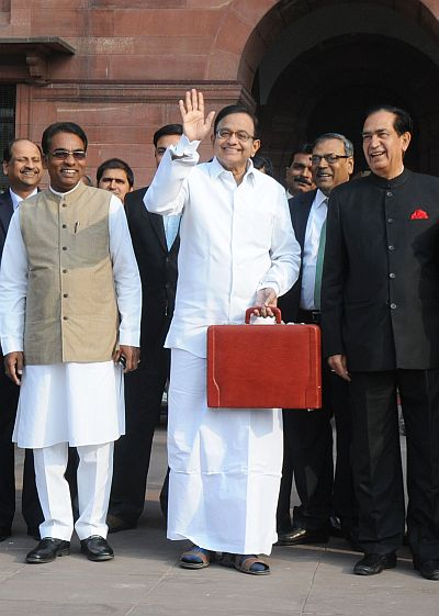 The Union Finance Minister, P. Chidambaram departs from North Block to Parliament House along with the Ministers of State for Finance, Namo Narain Meena (right) and Jesudasu Seelam to present the Interim Budget 2014-15, in New Delhi.