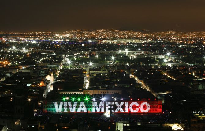 The national presidential palace is lit up in the colours of the Mexican flag during a sound and light show in Mexico City.