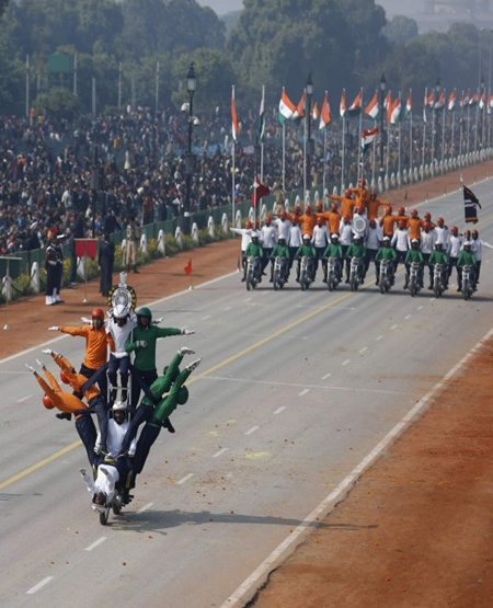 Indian soldiers perform a dare-devil show on their motorcycles during full dress rehearsal for the Republic Day parade in New Delhi.