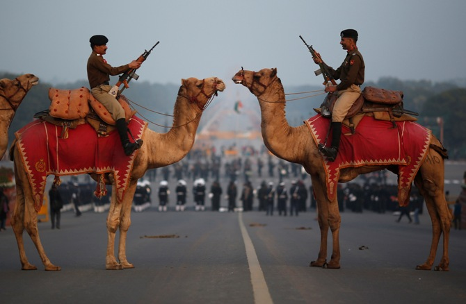 ndia's Border Security Force (BSF) soldiers ride their camels during a rehearsal for the 'Beating the Retreat' ceremony in New Delhi January 24, 2014.